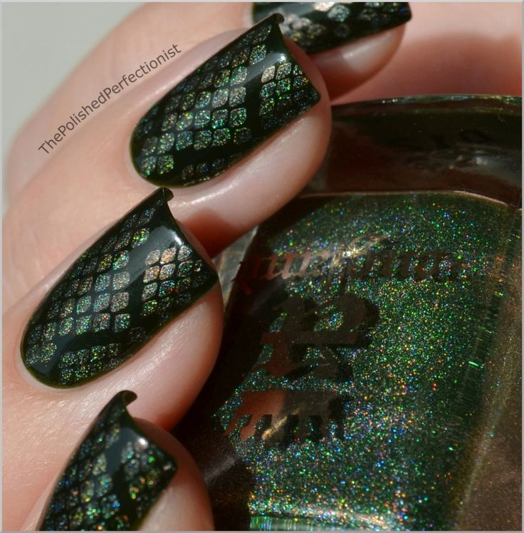 The polish perfectionist kills it with dragon scaled nails! Great use of konad technique.