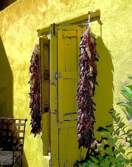 Chili Peppers hang in the doorway of this 1880 adobe rowhouse in the historic El Presidio Neighborhood. It is the oldest neighborhood in Tucson Arizona.