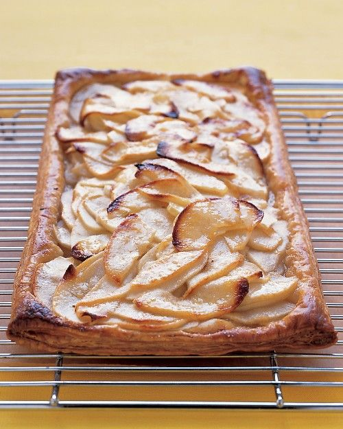 1 sheet frozen puff pastry (from a standard 17.3-ounce package), thawed  Flour, for work surface  3 Granny Smith apples  1/3 cup sugar  1 large egg yolk, beaten with 1 teaspoon water, for egg wash  2 tablespoons unsalted butter  2 tablespoons apple jelly, or apricot jam