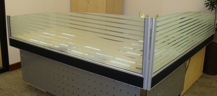 Glass office partitioning screens can marry stylish design with elements of privacy.