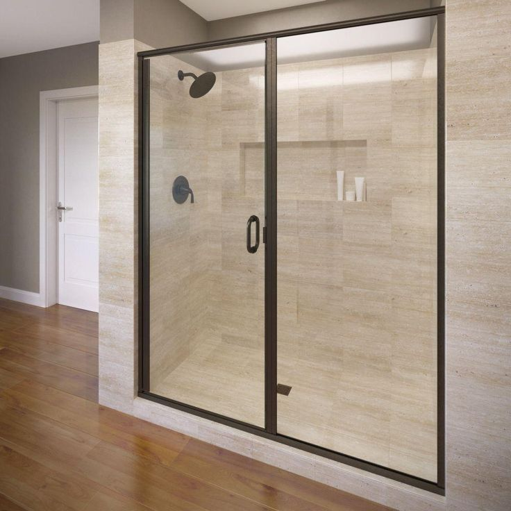 hinged shower door in oil rubbed bronze with aquaglidexp clear glass