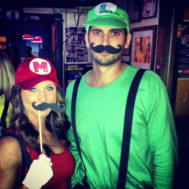 Mario and Luigi. For the competitive couple: whoever gets the most candy wins! Needed: overalls or blue jeans and suspenders, red and green shirts, red and green hats, cardboard, markers and sticks for mustaches. #halloween #couplescostumes