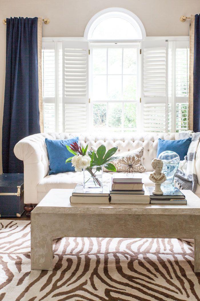 Front Room, Family Room, Modern Chic, Zebra Rug, Tufted Sofa, brass, concrete table www.styleyoursenses.com