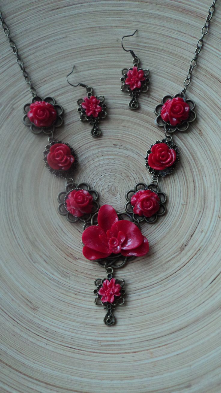 red necklace with red orchid and roses. $ 40