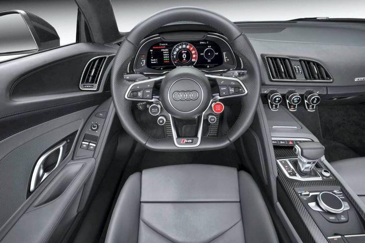 Audi R8 V10 Plus. Sous le capot de l'Audi R8 V10/V10 Plus  Moteur : V10 bi-injection essence Disposition : centrale longitudinale arrière Cylindrée : 5 204 cm3 Puissance : 540 /610 ch à 8 250 tr/min Couple : 540 /560 Nm à 6 500 tr/min Transmission : aux 4 roues Boîte: double embrayage 7 rapports Dimensions : 4 426 x 1 940 x 1 240 mm Coffre : de 112 l (+ espace derrière derrière les sièges) 0 à 100 km/h : 3,5 /3,2 s Vitesse : 320 /330 km/h Consommation : 11,4 /12,3 l CO2 : 272 /287 g