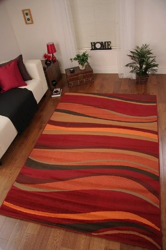 LOVE THIS RUG!    Thiswarmly coloured wave design rug is designed in shades of red, burnt orange, green, tan and brown. Made from 100% Polypropylene this rug is stain resistant, easy to clean and will add afeeling of warmthto any room.