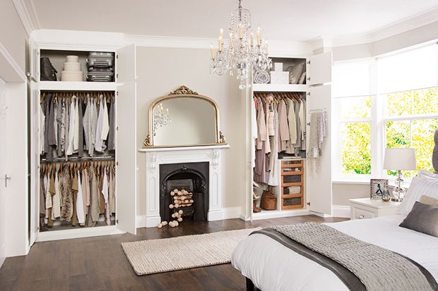 convert the niches on either side of fireplace to usable closet space instead of decorative shelving