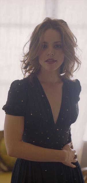LOVE the neckline of this dress, short sleeves, deep V, looks navy blue and polka dot.... Rachel mcadams has my style...