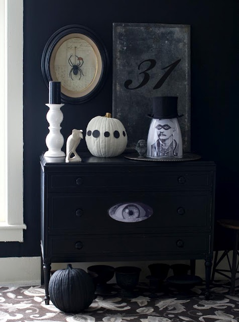 Decorating for Halloween: black and white with vintage gray details. I love the eye on the dresser!