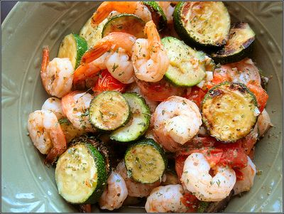 "SHRIMP with ZUCCHINI & TOMATOES:   1 tbsp. olive oil, extra-virgin, divided 2 medium-small zucchinis, cut 1/4"" thick 12oz. medium sized shrimp (peeled and deveined, cut tails off if desired) 1 cup cherry tomatoes, cut in half (I love Nature Sweet) 1/2 tsp. dried oregano 1/2 tsp. ground black pepper, or to taste 1/2 tsp. salt 2 cloves of garlic, minced 1/4 cup water"