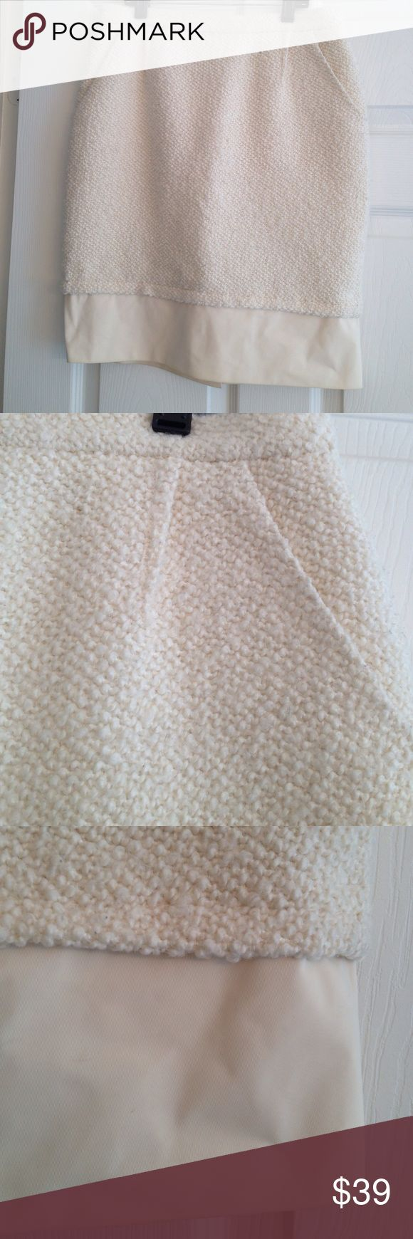 BCBG MAXAZRIA BOUCLE SKIRT😍 I adore this shade of Ivory. It has a hint of butter yellow in it! ;) Fantastic Wool blend Boucle .. Fully lined.. Built-in girly shape and a hemline that is a Great butter real colour in a heavy acrylic with just a hint of texture that my camera does not capture. In great condition. BCBGMaxAzria Skirts Pencil