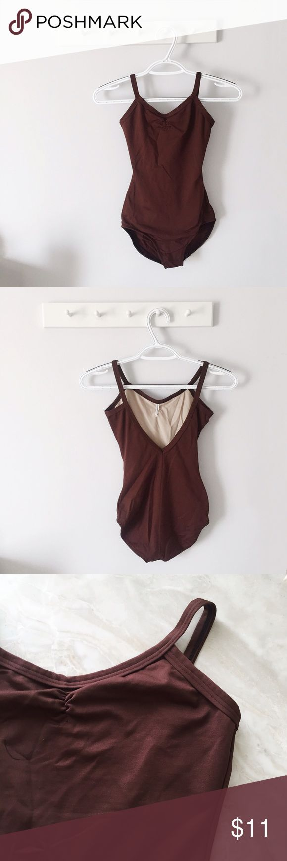 Brown Bodysuit/Leotard Brown Bodysuit/Leotard  * Great condition  * Camisole style * Women's small  * Brown  Styling Tip: Wear under skirt, pants, or to dance class   Please, no trades, all reasonable offers will be considered, & will ship within 1 business day ✨   8/16: uO17p11LO6-6m5 Tops