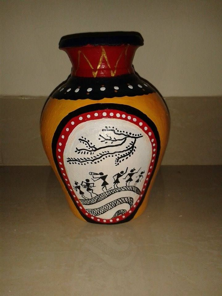 Warli painting on pot done by acrylic paint.