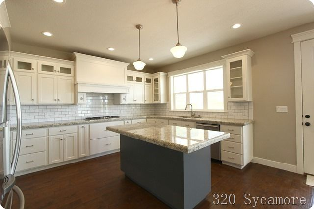 320 Sycamore's kitchen:  White dove cabs, revere pewter walls, giallo ornamental granite.