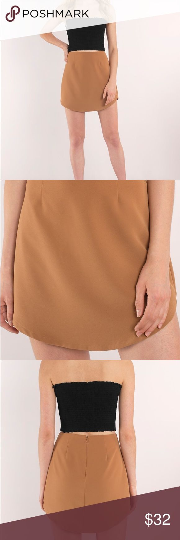 🆕 NWOT 💎 Tobi Celise Mini Skirt in Carmel Dress this beautiful piece up for a night out, or with a sweater and tights for a casual weekend day! This skirt is in a beautiful camel color, perfect for fall! :)  This skirt has never been worn! Tobi Skirts Mini