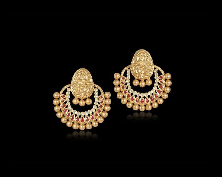 Stunning #kundan-studded earrings featuring lush leaves fringed with tiny #golden #pearls - they are all set to stun those around! #GehnaJewels #Jewelry #Jewellery