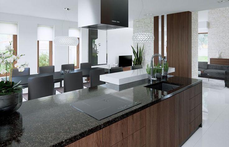 #kitchen Kuchnia z wyspą jest idealnym rozwiązaniem kiedy mamy do zagospodarowania dużą przestrzeń. Często jest dodatkowym miejscem przygotowania posiłków. Ciemny odcień mebli przełamuje jasne wnętrze. Ściana oddzielająca salon od kuchni a także ciekawe  oświetlenie nadają nowoczesny charakter wnętrzu pasujący do wizji projektanta dotyczącej wyglądu domu.