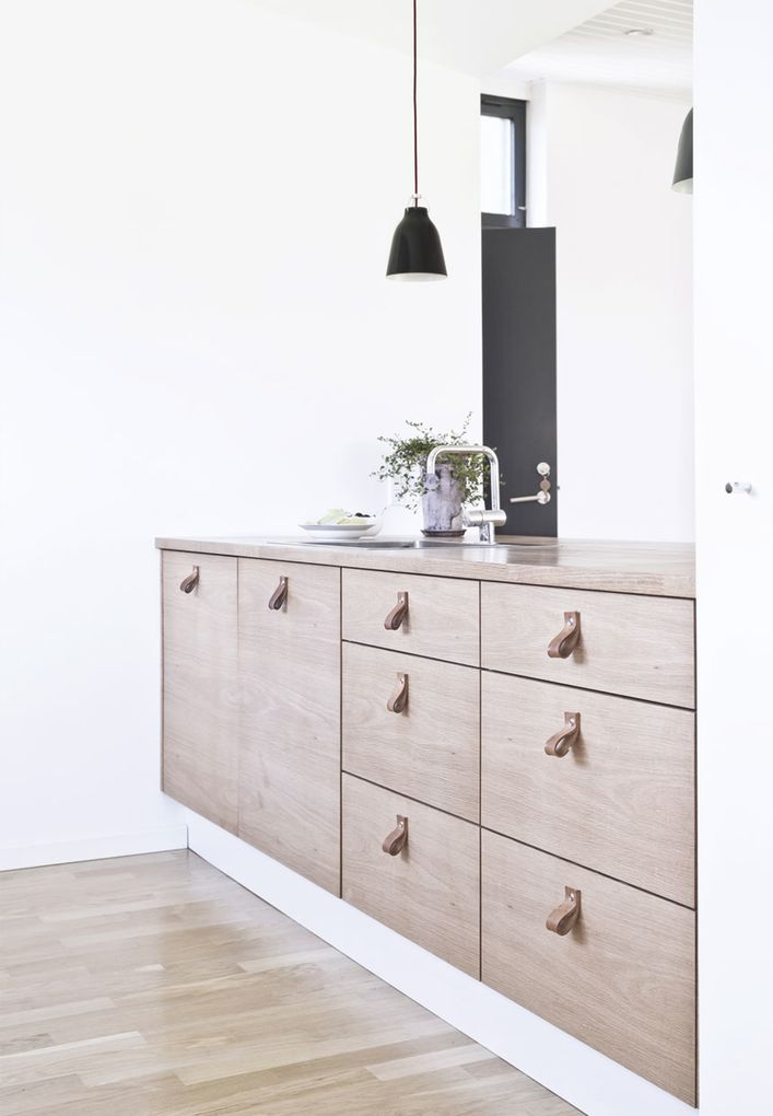 minimal kitchen with leather handles