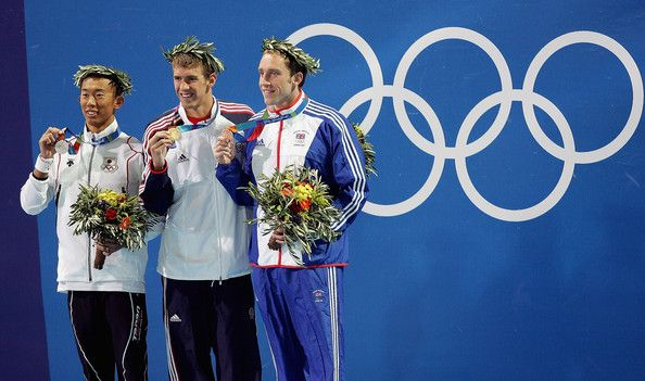 Michael Phelps Photos Photos - (L-R) Takashi Yamaoto of Japan, Michael Phelps of USA and Stephen Parry of Great Britain pose with their medals for the men's swimming 200 metre butterfly event on August 17, 2004 during the Athens 2004 Summer Olympic Games at the Main Pool of the Olympic Sports Complex Aquatic Centre in Athens, Greece. - Olympics Day 4 - Swimming