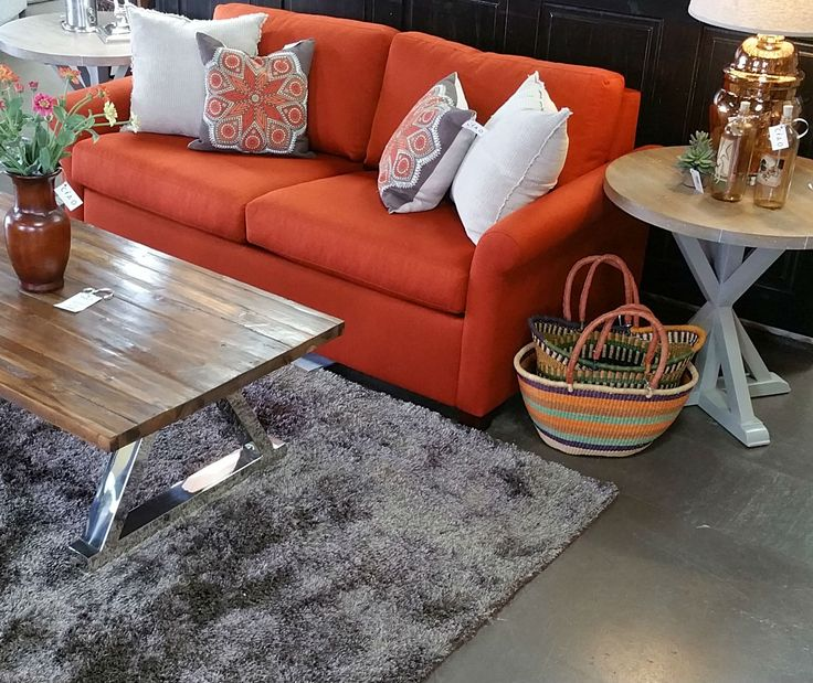 Orange is in it's most glorious shade on this American Leather Comfort Sleeper. Paired perfectly with the Uttermost reclaimed fir wood coffee table, Fauld end tables and Zeugma Imports glass lamp. Stop in our downtown Kalispell, MT showroom. We have so many more room settings, decor and accent pieces - something for every budget.