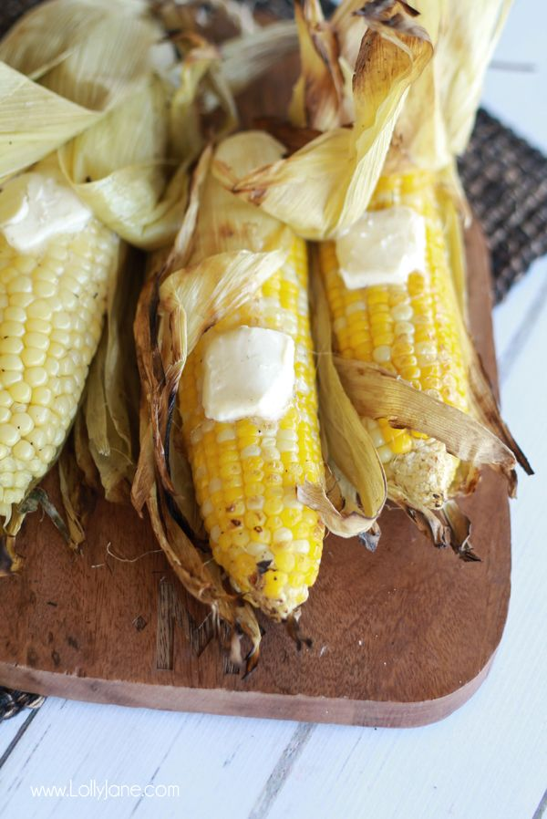 Perfectly grilled corn on the cob. Learn how to grill it with the husks on! via lollyjane.com