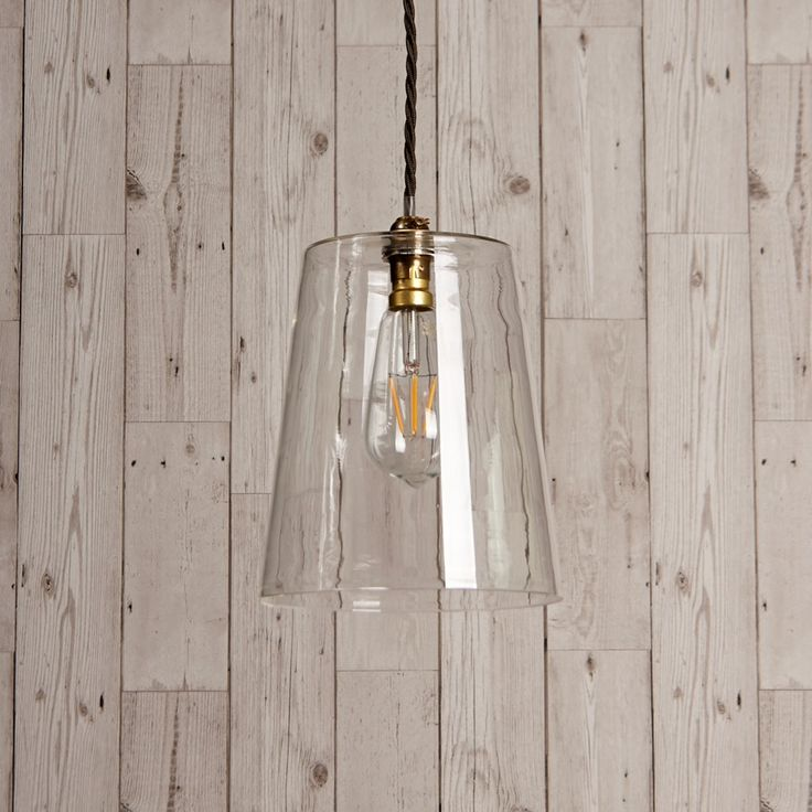 This slightly tapered clear glass pendant combined with the right fitting and bulb strikes a very sophisticated pose