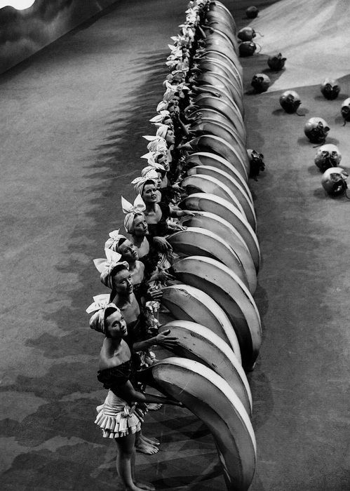 """Banana-wielding chorus girls on the set of Busby Berkeley's The Gang's All Here (1943) rehearse the Lady in the Tutti-Frutti Hat routine, which was aptly described by one critic as """"a male hairdresser's acid trip"""""""