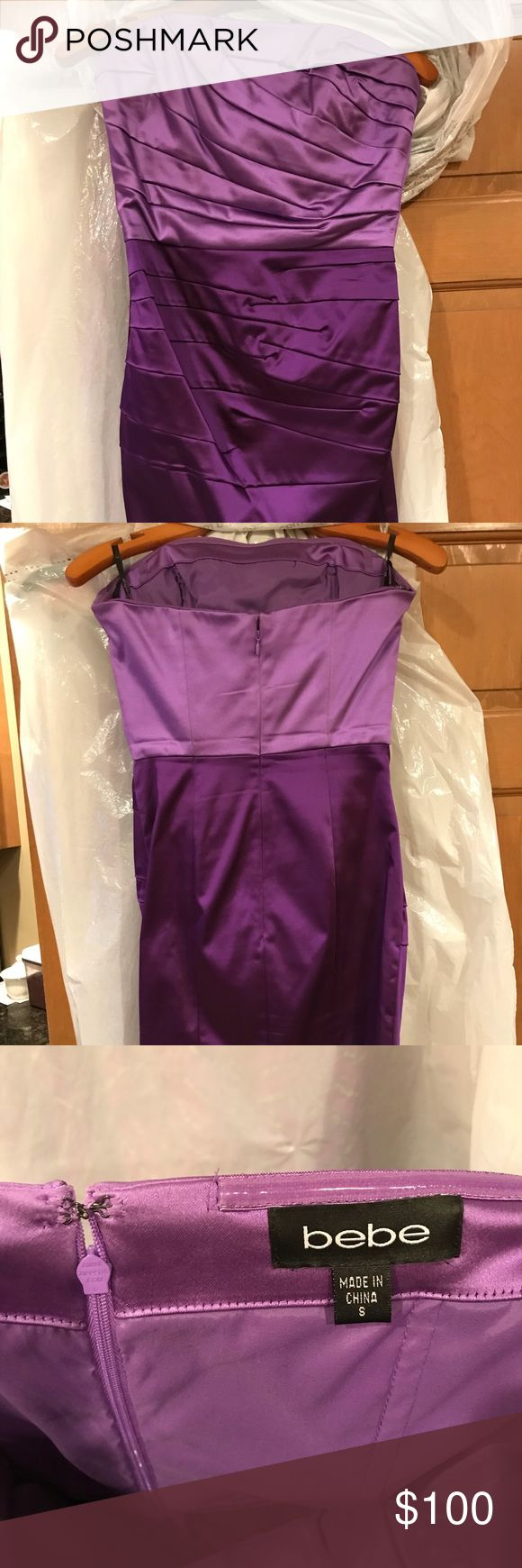 Two Tone Purple Dress by Bebe This is a two tone purple bodycon dress. This dress is very flattering and has ruching in all the right places. The material of this dress is a stretchy sating that confirms to all body shapes. This dress is in excellent condition. bebe Dresses Prom
