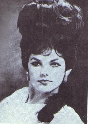 Priscilla Presley was my aspiration for achieving an awesome retro bouffant in the 80s. She definitely wins on height, style, and beauty.