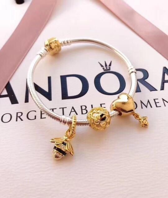 83725774a Pandora yellow gold shine queen bee charm bracelet in 2019 ...