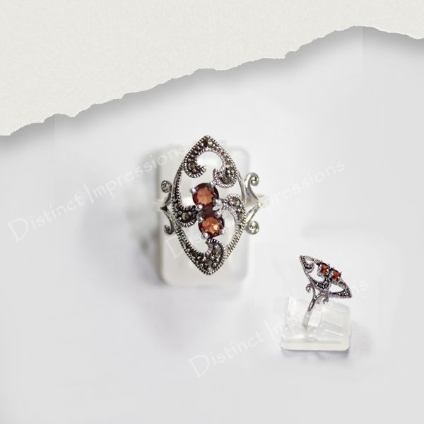 Combining the delicate classic marcasite style and the beautiful garnet this sterling silver ring is sure to make a standout addition to your collection.