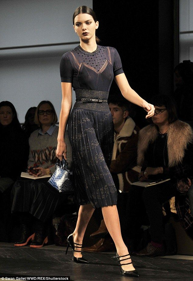 Immaculate: The star's look was completed with a pair of Mary Janes heels, a blue handbag ...