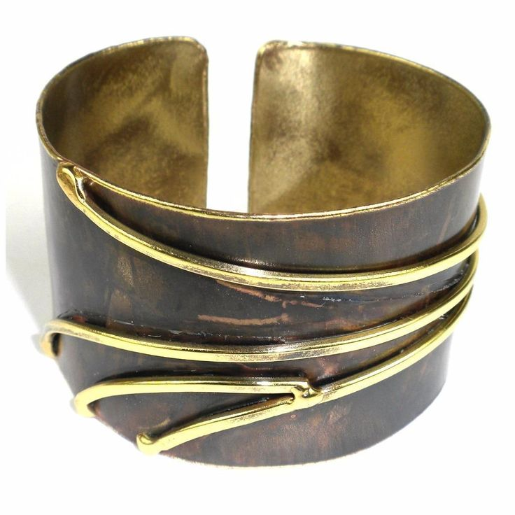 Handcrafted by South African artisans, this darkened brass cuff is accented with waves of brilliant brass. This cuff is 1.5 inches tall. The pattern and color on the brass is achieved by applying extreme heat rather than paints or dyes. Adjustable, the diameter of the cuff is 2.25 inches.