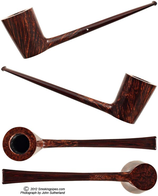 Paolo Becker is like an Italian Pipemaking god.  His pipes are works of art.  Period.  This pipe is compared to a super model.  I think it's way prettier than that.