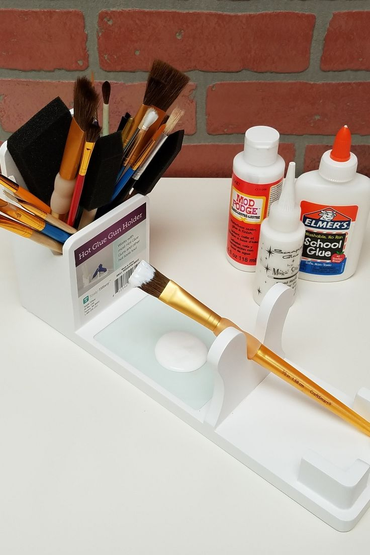Hot glue gun stand is a paint brush stand too.