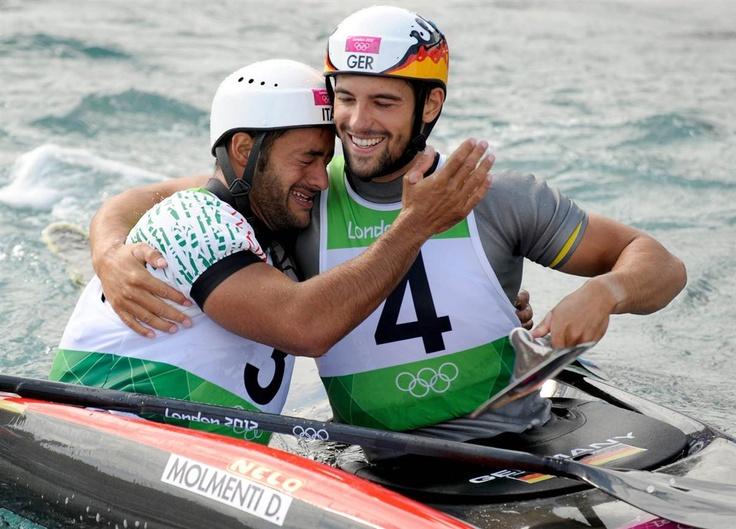 Italian Daniele Molmenti, left, hugs German Hannes Aigner after his final run in the men's kayak slalom. Molmenti won the gold medal.
