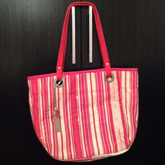 American Eagle Outfitters pink striped canvas bag Cute pink striped American Eagle Outfitters canvas tote bag. Silver metal hardware with keychain charm. Good condition. No stains inside or outside of bag. Handles are slightly worn (pic 4). Length approx 10 inch Width 9 1/2 to 13 1/2 (depending what you put) & Depth 5 inch expanded. Inside has zip pocket. Bag has zip closure. Some clear sequins parallel to strip line. American Eagle Outfitters Bags Totes