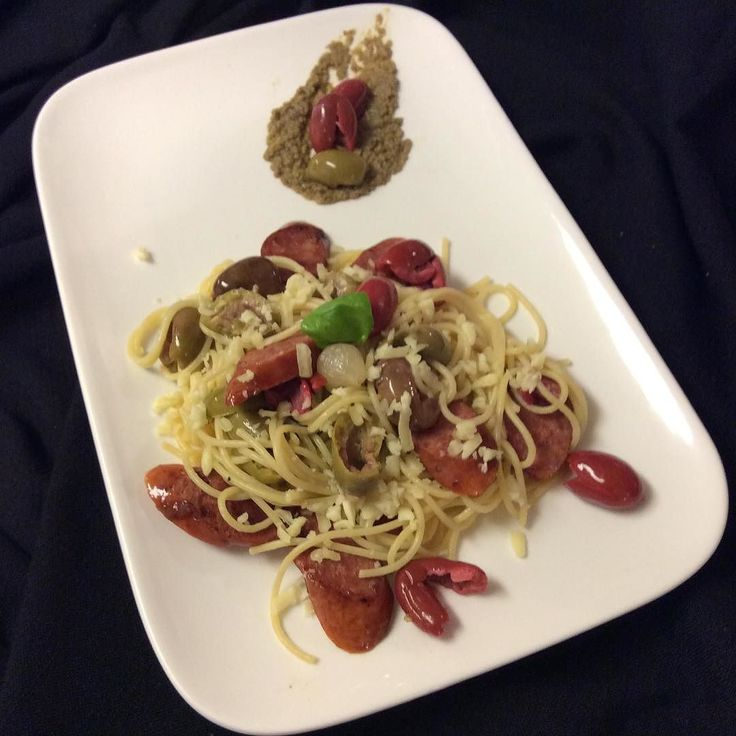 Spaghetti with Italian sausages  three types of olives top with mozzarella cheese drizzle some olive oil over the spaghetti and garnished with green crushed olive spread. Note when buying olives always with the pit in crushed olive just prior to use much more flavourful olive Great tip from Jamie Oliver #spaghetti #pasta #olive #jamieoliver #greenolives #flavourful #italiansausage #oliveoil #mozzarella #cheese #catellipasta @jamieoliver @catellipasta @syscocanada @syscoatlanta @syscoatlanta…