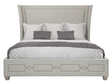 grey upholstered headboard with nailhead detail on footer available at avenue design canada in montreal