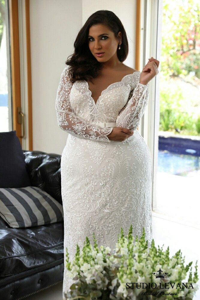 Stunning lace, long sleeves, V neck, fitted skirt, all in Milena, super flattering plus size bridal gown ! For a fashion forward curvy bride