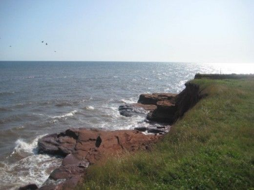Red cliffs along the ocean in PEI, Canada.