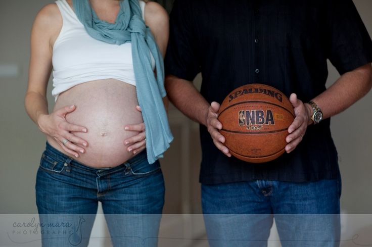 I love this kind of shot... it's a great way to compare/contrast Mom-and-her-tummy against Dad-and-a-basketball.  Nice couple shot.