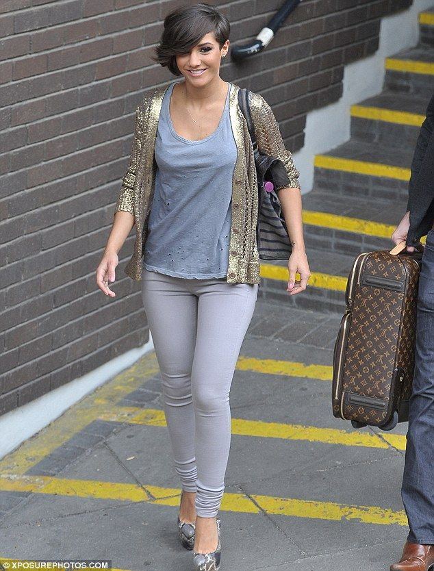Frankie Sandford jeans with a grey top, gold cardigan