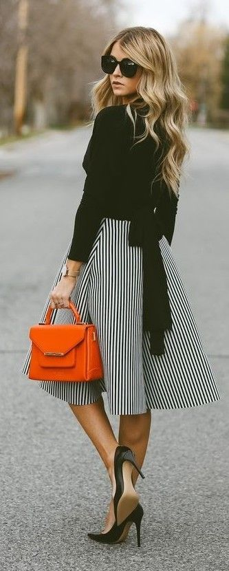 Spring fashion | Striped midi dress, black shirt and heels with orange tote bag