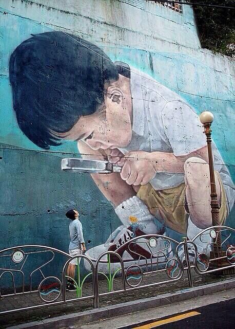 Talk about feeling small in this world. This Street Art artist is able to bring the curiosity of a child and an adults insecurities of where they belong into one painting! Way to go!