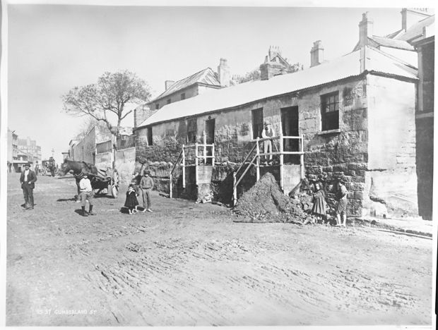 Images of Australia: the Tyrrell Collection of photographs of Australias history.Cumberland Street, The Rocks. During the course of the 19th century the social diversity of the original close settlement around the port of Sydney was lost. The affluent residents vacated their large houses on the ridge for the growing suburbs and The Rocks became an area of seamen and immigrants, the working class and the poor. Many outsiders considered the area still tainted by the convict stain