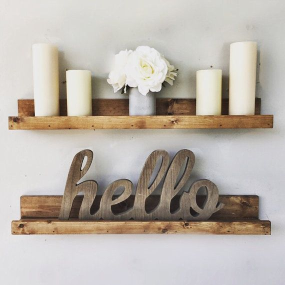This handmade ledge shelf can accent any wall in your home. Its sleek, modern but rustic. They come it different sizes so please choose the length and finish of your choosing. The shelf on display is 30 long x 5 wide. The shelf has a usable shelf pace of 3.5. The stain is Provincial. The shelf come with pre-drill keyholes so the shelf will be flush with the wall. Also, we always welcome custom orders as we know everyone has different needs and taste. Please note this is a rustic piece, so...