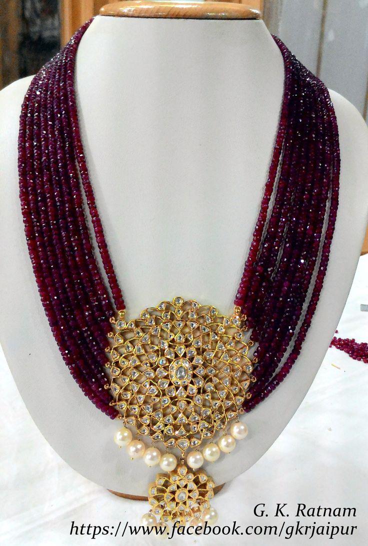 A royal diamond polki pendant set with rubies.