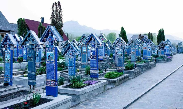 World's Most Stunning Cemeteries - Business The Merry Cemetery, on the border between Romania and the Ukraine, is famous for its blue painted grave markers that depict scenes from the deceased's life.