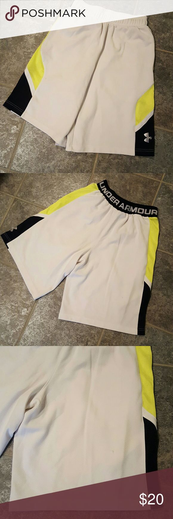 Under Armour shorts It has a couple snags on it but is still in good condition.  This is a guys small. Under Armour Shorts
